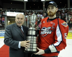 Windsor captain Harry Young accepts Wayne Gretzky Trophy from OHL Commissioner David Branch