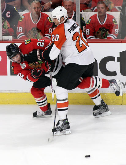 Chris Pronger works on Troy Brouwer in Game One of Stanley Cup  Final