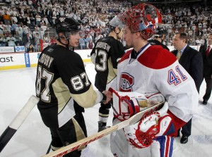 Penguins' captain Sidney Crosby looks into Jaroslav Halak's eyes - to confirm he is human