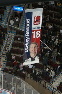 Banner remembering Mickey Renaud