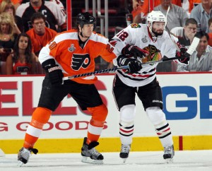 Chris Pronger (left) has made Blackhawks' forwards pay the price for every inch of ice they get