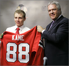 Then-Hawks' GM Dale Tallon (right) after drafting Patrick Kane in 2007