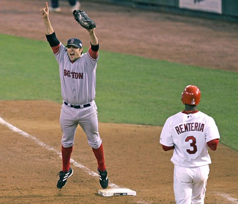 Red Sox' first baseman Doug Mientkiewicz makes final out of 2004 World Series, ending Sox' 86-year drought
