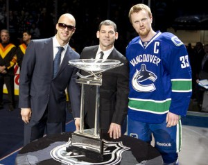 Manny Malhotra and Henrik Sedin accept 2011 Presidents' Trophy from Kris King
