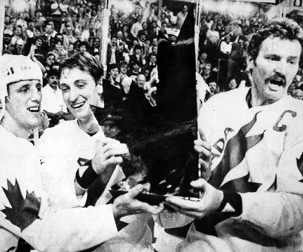 Mike Bossy NYI, Wayne Gretzky EDM and Larry Robinson MTL hoist 1984 Canada Cup